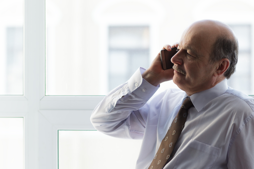 Serious business man on phone call - Igniyte